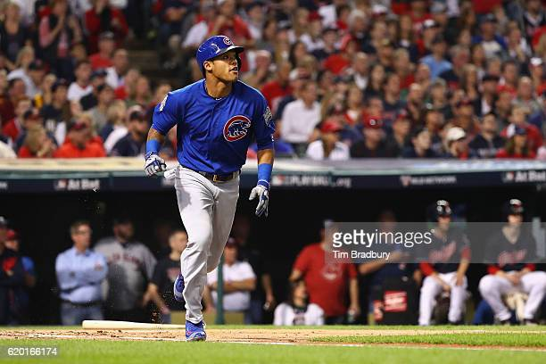 Addison Russell of the Chicago Cubs runs after hitting a tworun RBI double during the first inning against the Cleveland Indians in Game Six of the...