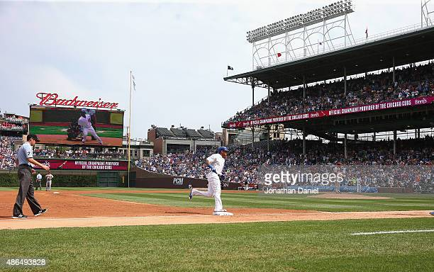 Addison Russell of the Chicago Cubs runs the bases after hitting a solo home run in the 2nd inning against the Arizona Diamondbacks at Wrigley Field...