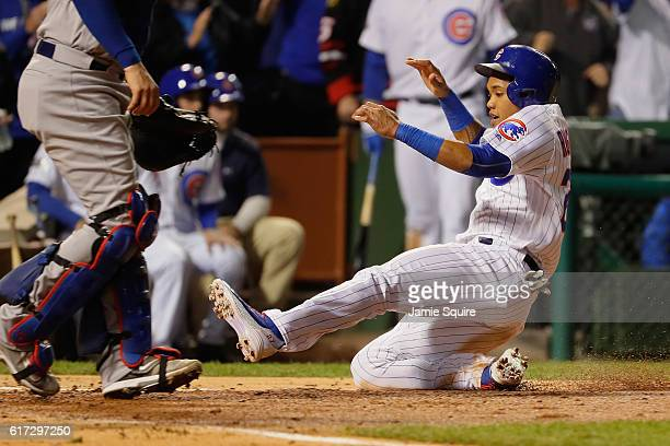 Addison Russell of the Chicago Cubs scores a run on an RBI single hit by Dexter Fowler in the second inning against the Los Angeles Dodgers during...