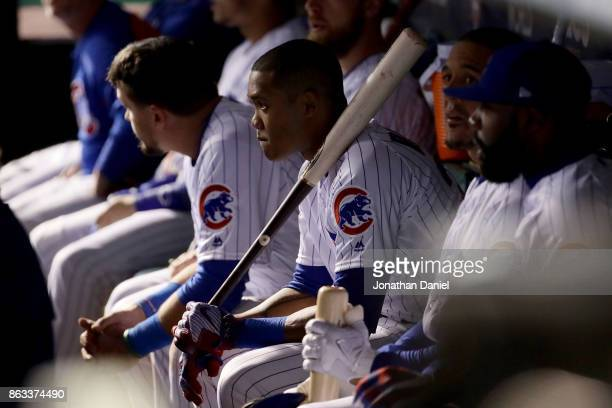 Addison Russell of the Chicago Cubs sits on the bench in the ninth inning against the Los Angeles Dodgers during game five of the National League...