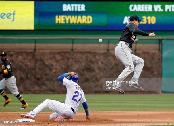 Addison Russell of the Chicago Cubs steals second base as Jordy Mercer of the Pittsburgh Pirates is unable to catch the throw during the fourth...