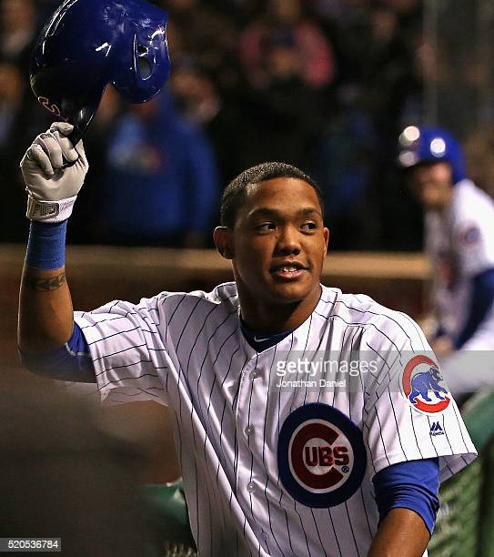 Addison Russell of the Chicago Cubs take a curtain call after hitting a gamewinning three run home run in the 8th inning against the Cincinnati Reds...