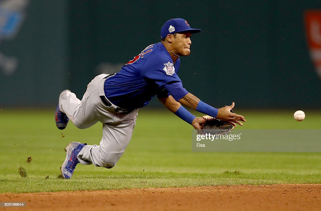 Addison Russell #27 of the Chicago Cubs throws the ball to Javier Baez #9 (not pictured) to force out Lonnie Chisenhall #8 of the Cleveland Indians (not pictured) at second base during the sixth inning in Game Six of the 2016 World Series at Progressive Field on November 1, 2016 in Cleveland, Ohio.
