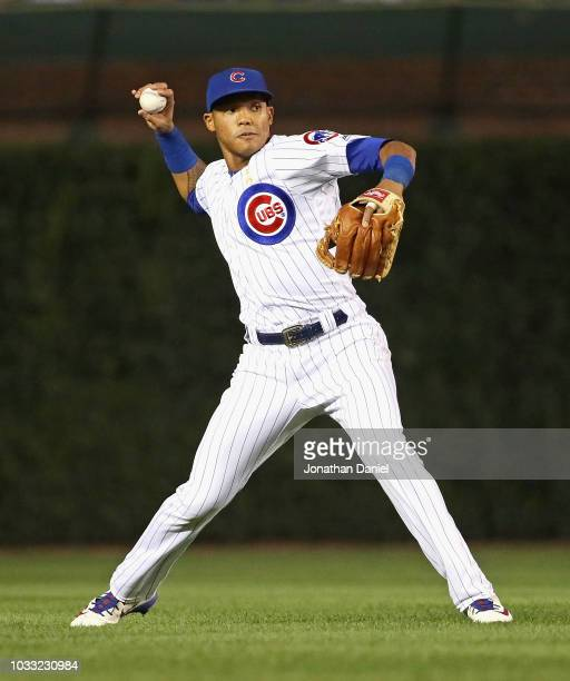 Addison Russell of the Chicago Cubs throws to the infield against the Milwaukee Brewers at Wrigley Field on September 12 2018 in Chicago Illinois The...