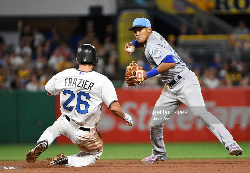 Addison Russell #27 of the Chicago Cubs turns a double play against Adam Frazier #26 of the Pittsburgh Pirates in the seventh inning during the game at PNC Park on June 17, 2017 in Pittsburgh, Pennsylvania.