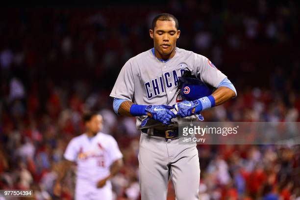 Addison Russell of the Chicago Cubs walks off the field after making the final out of the game against the St Louis Cardinals at Busch Stadium on...