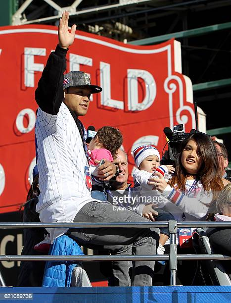 Addison Russell of the Chicago Cubs waves to the crowd during the 2016 World Series victory parade on November 4 2016 in Chicago Illinois The Cubs...