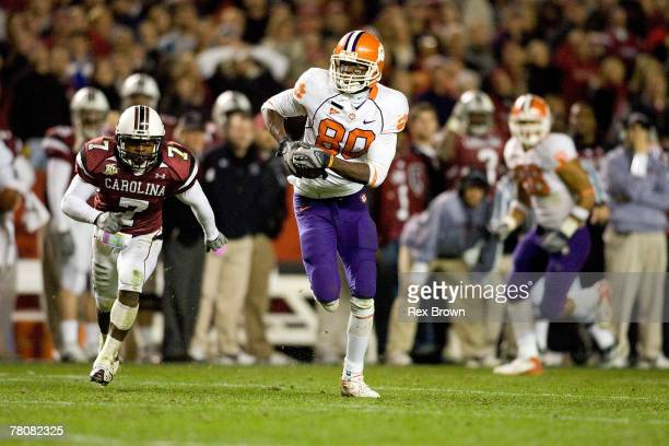 Addison Williams of the South Carolina Gamecocks defends as Aaron Kelly of the Clemson Tigers picks up a first down on 4th and 4 at Williams-Brice...