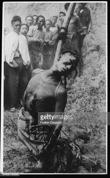 Additional Hulton Text Well Aimed Original caption Execution Of Highway Robbers At Chia Tsoa Honan 1912