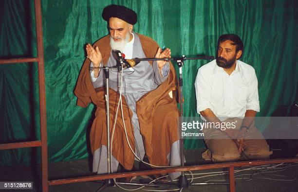 Addressing his followers at the Tehran Iran mosque adjoining his home is the Ayatollah Ruhollah Khomeini