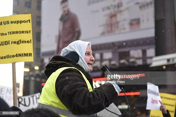 Addressing the multitude with passion as flurries begin Hundreds of Muslims gathered in Times Square to protest against the Saudi government's...