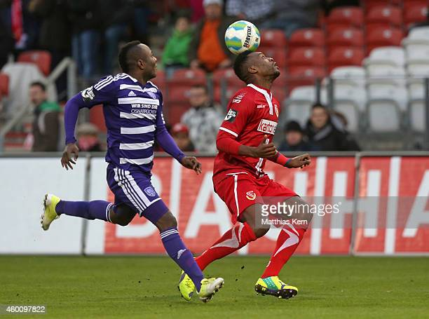Addy Waku Menga of Osnabrueck battles for the ball with Ebewa Yam Mimbala of Cottbus during the third league match between FC Energie Cottbus and VFL...