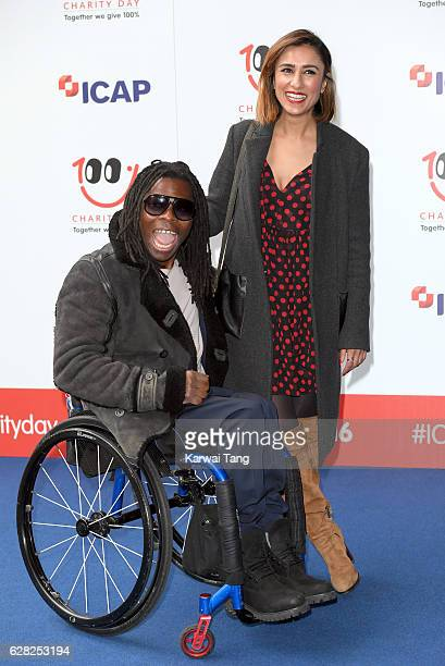 Ade Adepitan and Anita Rani attend the ICAP's 24th annual charity trading day in aid of Sentebale at ICAP on December 7 2016 in London England The...