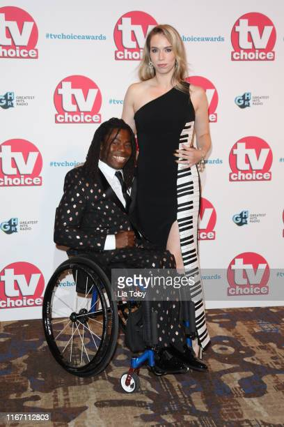 Ade Adepitan and Linda Harrison attend The TV Choice Awards 2019 at Hilton Park Lane on September 9 2019 in London England