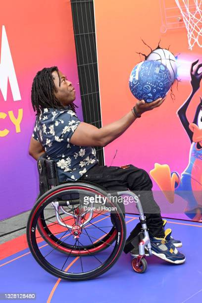 """Ade Adepitan attends a special screening of """"SPACE JAM: A NEW LEGACY"""" in cinemas 16th July at Cineworld Leicester Square on July 11, 2021 in London,..."""