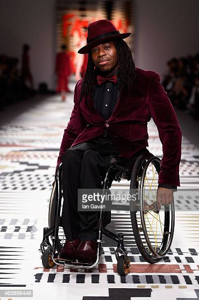 Ade Adepitan attends the Fashion For Relief charity fashion show to kick off London Fashion Week Fall/Winter 2015/16 at Somerset House on February 19...