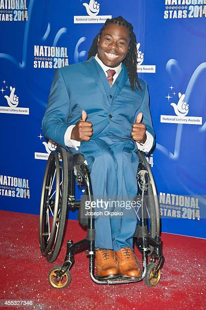 Ade Adepitan attends the National Lottery Awards at Pinewood Studios on September 12 2014 in Iver Heath England