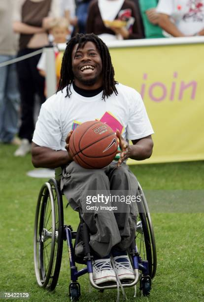 Ade Adepitan has a go at the basketball shoot during the London 2012 'Roadshow' for the London 2012 Olympics at Finsbury Park on July 15 2007 in...