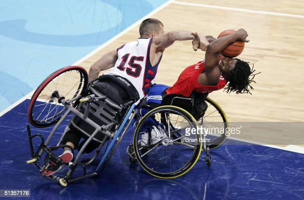 Ade Adepitan of Great Britain gets fouled by Jeff Glasbrenner of the USA with the score tied and 75 seconds left in the game during the quarterfinals...