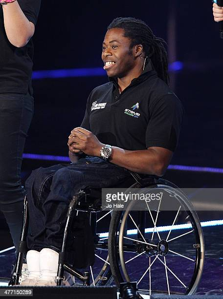 Ade Adepitan on stage for We Day UK event at Wembley Arena on March 7 2014 in London United Kingdom