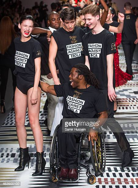 Ade Adepitan on the runway at the Fashion For Relief charity fashion show to kick off London Fashion Week Fall/Winter 2015/16 at Somerset House on...
