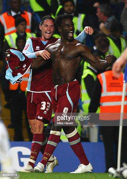 Ade Akinbiyi of Burnley celebrates his goal with Chris Eagles during the Carling Cup Fourth Round match between Chelsea and Burnley at Stamford...