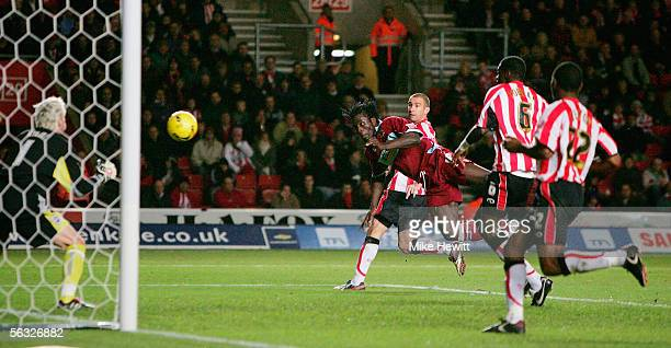 Ade Akinbiyi of Burnley equalises with a diving header past Antti Niemi of Southampton during the CocaCola Championship match between Southampton and...