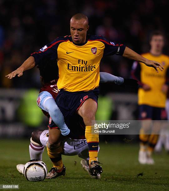 Ade Akinbiyi of Burnley in action with Mikael Silvestre of Arsenal during the Carling Cup quarter final match between Burnley and Arsenal at Turf...