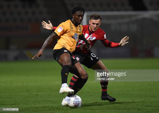 Ade Azeez of Cambridge United is challenged by Harry Hamblin of Southampton during the Checkatrade Trophy Southern Group B match between Cambridge...