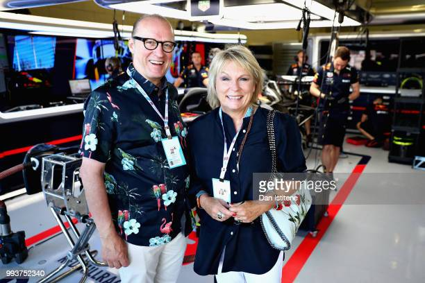Ade Edmondson and Jennier Saunders pose for a photo in the Red Bull Racing garage before the Formula One Grand Prix of Great Britain at Silverstone...