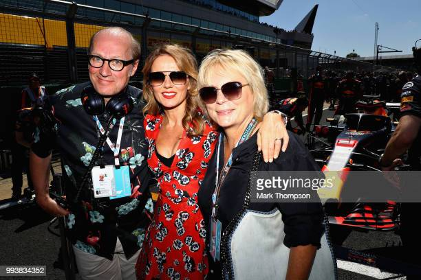 Ade Edmondson Jennier Saunders and Geri Horner pose for a photo on the grid with Red Bull Racing before the Formula One Grand Prix of Great Britain...