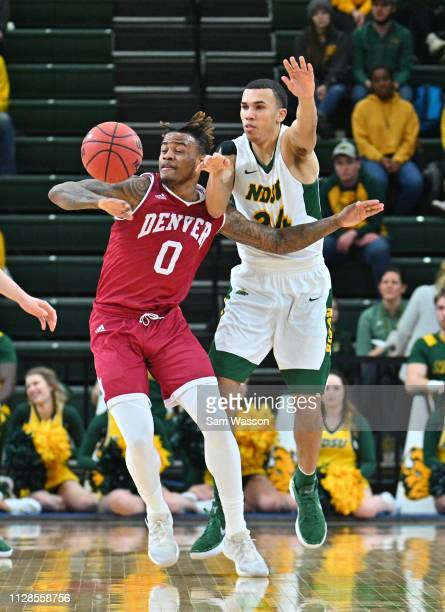Ade Murkey of the Denver Pioneers and Tyson Ward of the North Dakota State Bison battle for a loose ball during their game at Scheels Center on...