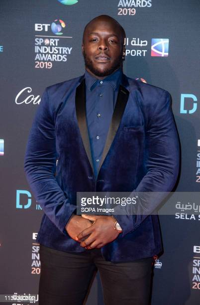 Adebayo Akinfenwa appears on the red carpet ahead of the BT Sport Industry Awards 2019 at Battersea Evolution