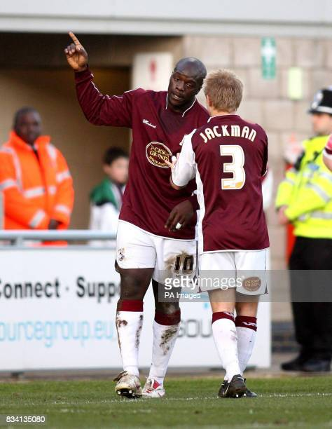 Adebayo Akinfenwa celebrates his goal for Northampton Town with Danny Jackman during the League One match at Sixfields Stadium Northampton