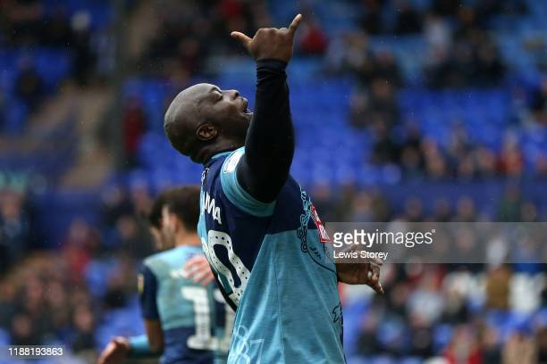 Adebayo Akinfenwa celebrates scoring his sides first goal during the Sky Bet League One match between Tranmere Rovers and Wycombe Wanderers at...