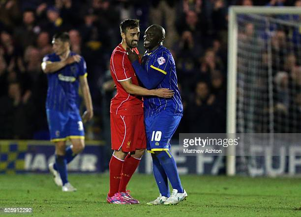 Adebayo Akinfenwa of AFC Wimbledon and Jose Enrique of Liverpool at the end of the match