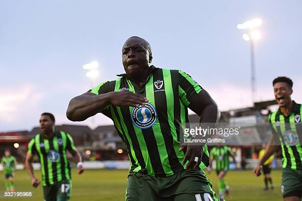 Adebayo Akinfenwa of AFC Wimbledon celebrates after scoring a goal to level the aggregate scores at 2-2 during the Sky Bet League Two play off,...