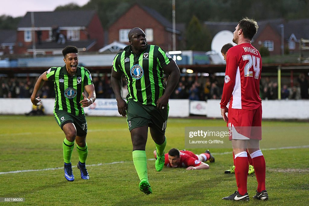 Adebayo Akinfenwa of AFC Wimbledon celebrates after scoring a goal to level the aggregate scores at 2-2 during the Sky Bet League Two play off, Second Leg match between Accrington Stanley and AFC Wimbledon at The Crown Ground on May 18, 2016 in Accrington, England.