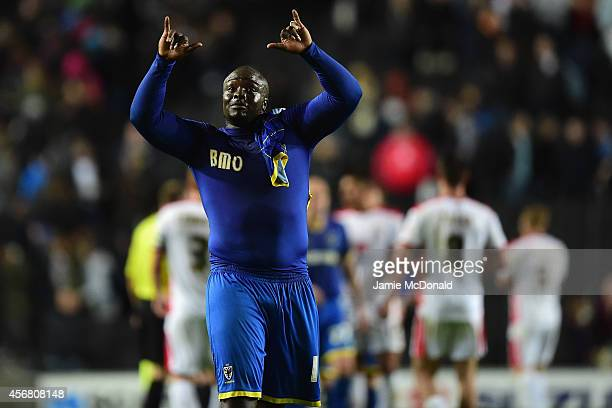 Adebayo Akinfenwa of AFC Wimbledon celebrates victory during the Johnstone's Paint Trophy Southern Section Second Round match between MK Dons and AFC...
