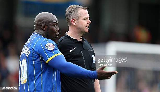 Adebayo Akinfenwa of AFC Wimbledon makes a point to referee Chris Sarginson during the Sky Bet League Two match between AFC Wimbledon and Northampton...