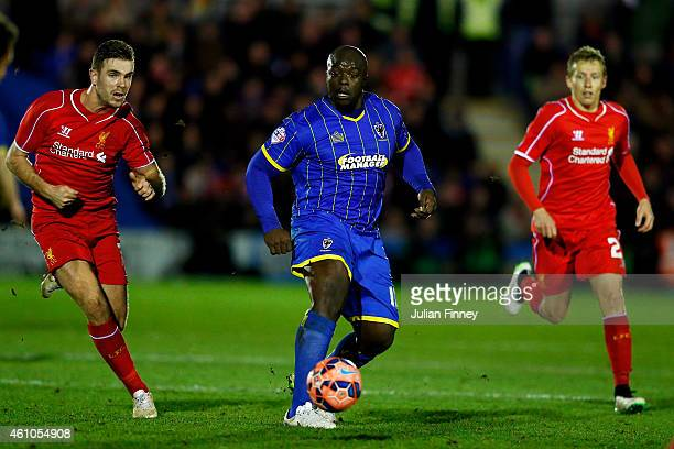Adebayo Akinfenwa of AFC Wimbledon runs with the ball during the FA Cup Third Round match between AFC Wimbledon and Liverpool at The Cherry Red...