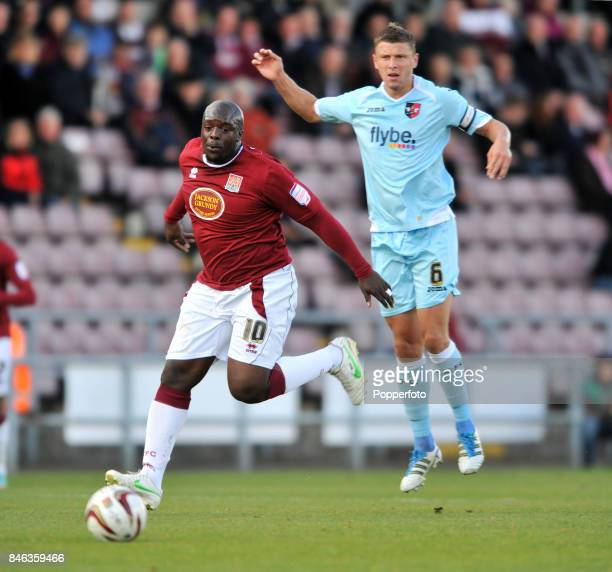 Adebayo Akinfenwa of Northampton Town and Danny Coles of Exeter City in action during the npower League Two match between Northampton Town and Exeter...