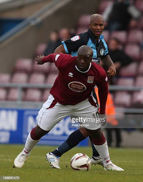 Adebayo Akinfenwa of Northampton Town attempts to control the ball under pressure from Leon Johnson of Wycombe Wanderers during the npower League Two...