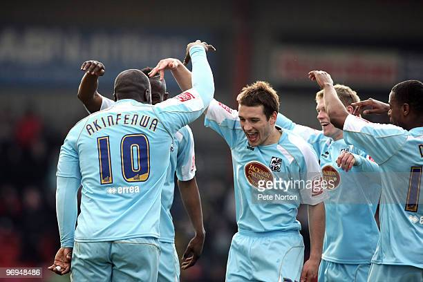 Adebayo Akinfenwa of Northampton Town celebrates with team mates after scoring his sides second goal during the Coca Cola League Two Match between...