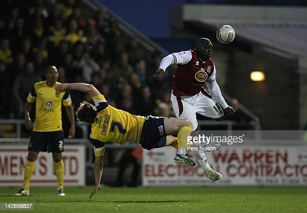 Adebayo Akinfenwa of Northampton Town contests the ball with Adam Chapman of Oxford United during the npower League Two match between Northampton...