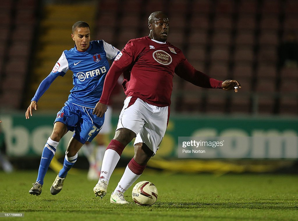 Adebayo Akinfenwa (R) of Northampton Town controls the ball watched by Alex Smith of Leyton Orient during the Johnstone's Paint Trophy Quarter Final match between Northampton Town and Leyton Orient at Sixfields Stadium on December 5, 2012 in Northampton, England.