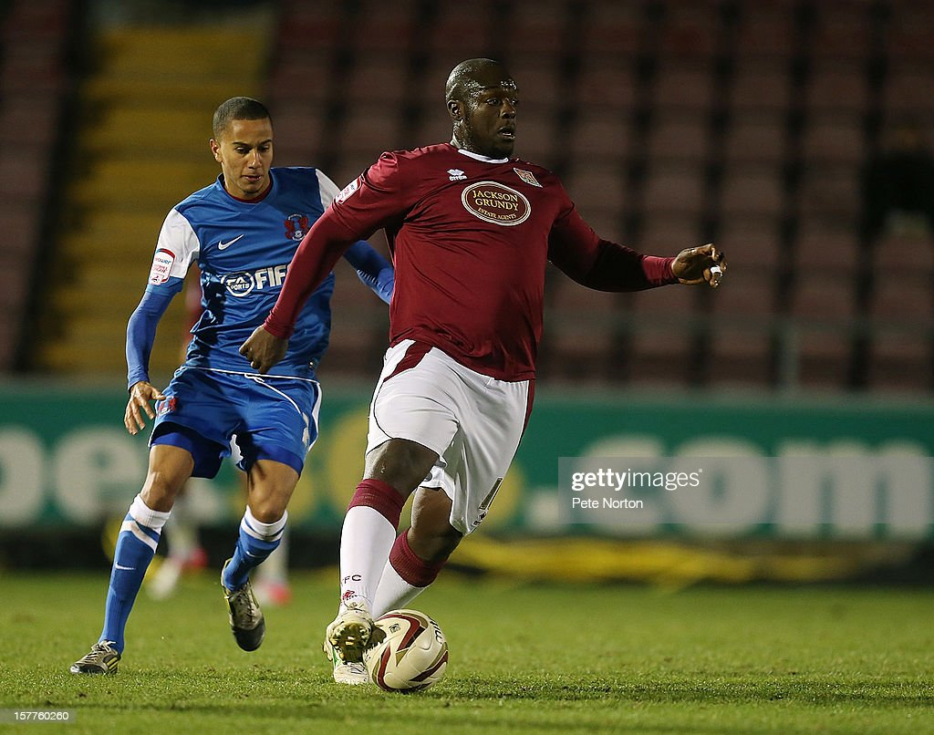 Adebayo Akinfenwa of Northampton Town controls the ball watched by Alex Smith of Leyton Orient during the Johnstone's Paint Trophy Quarter Final match between Northampton Town and Leyton Orient at Sixfields Stadium on December 5, 2012 in Northampton, England.