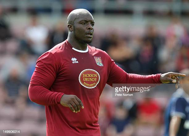 Adebayo Akinfenwa of Northampton Town in action during the preseason friendly match between Northampton Town and Tottenham Hotspur at Sixfields on...