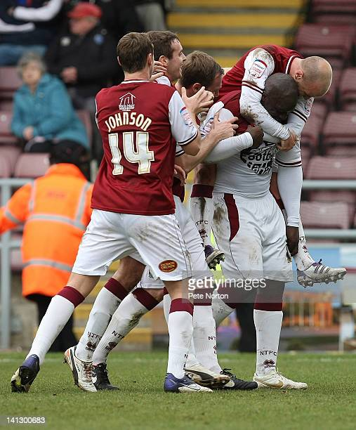 Adebayo Akinfenwa of Northampton Town is congratulated by team mates after scoring his first and his teams second goal during the npower League Two...