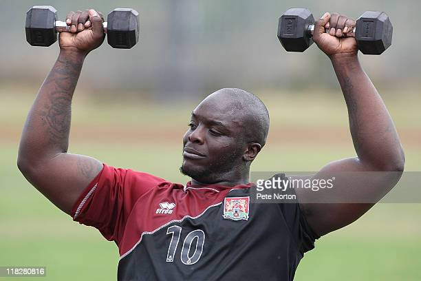 Adebayo Akinfenwa of Northampton Town lifts weights during a training session at Sixfields Stadium on July 4 2011 in Northampton England